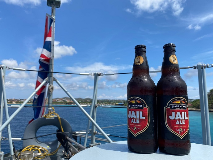 Jail Ale on board warship HMS Tamar with Union flag flying